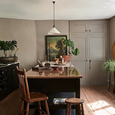 Kitchen with black cabinets and taupe walls.