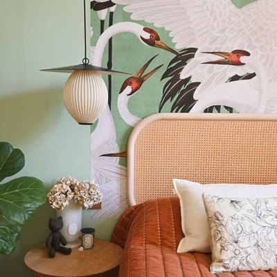 mint green walls with Gucci Heron wallpaper accent wall