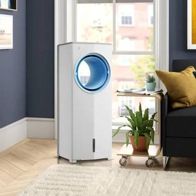 A white portable evaporative cooler in a living room