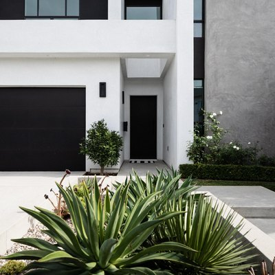 A black and white modern home and a garden