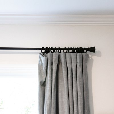 A close-up view of curtains with drapery rings