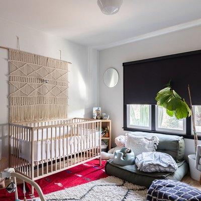 A nursery with a room darkening roller shade