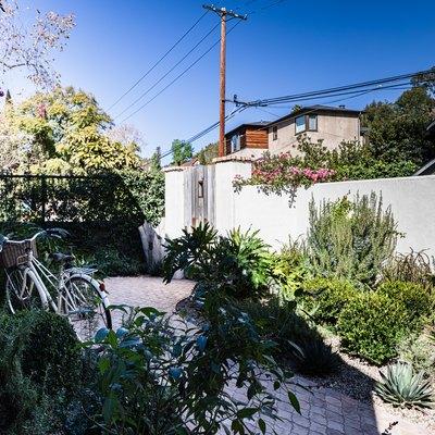 A mediterranean home with a garden