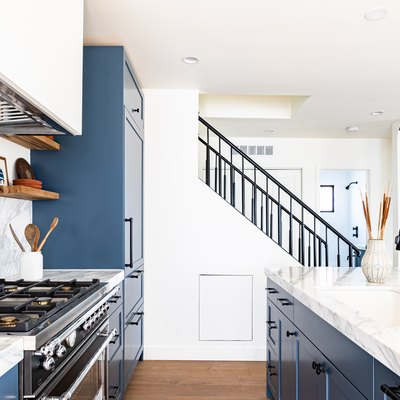 white, marble, and blue diy kitchen remodel
