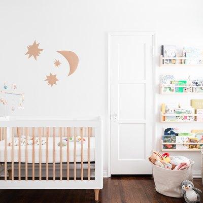 A white crib in a white nursery
