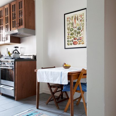 Wooden dining room table in a small kitchen