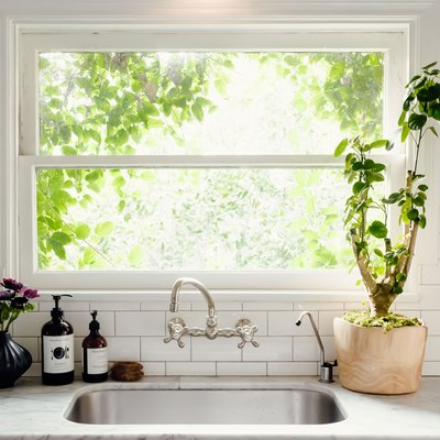 wall mounted faucet with undermount sink and white subway tile backsplash
