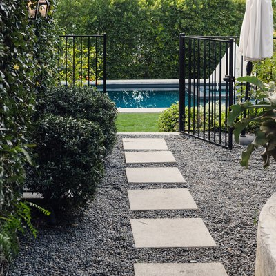 slate walkway on gravel to pool area