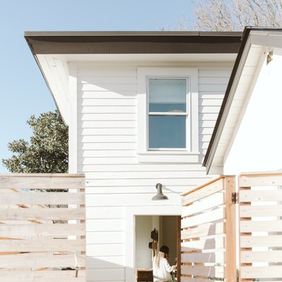 side door to wooden house