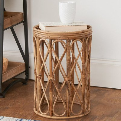With bohemian elements and a natural feel, our Curvy Cane Side Table will elevate the free spirit in your living room. The mixed tones of dark and light rattan add depth to this fun piece!