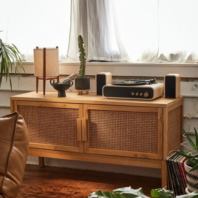 This media console brings a modern, bohemian aesthetic to your space. With 2 rattan-covered doors in a natural finish that hinge open to reveal interior storage. Complete with simple block handles + four sturdy removable legs.