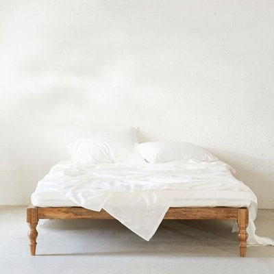 Carved from sustainable mango wood, our UO-exclusive Bohemian Platform Bed adds an understated rustic touch. Complete with a sturdy slatted design so no box spring is needed!
