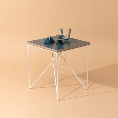 Side table or nightstand with clean lines and white legs.
