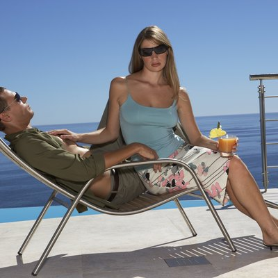 Couple lounging by ocean