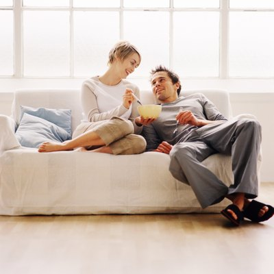 low angle view of a couple sitting on a couch and eating