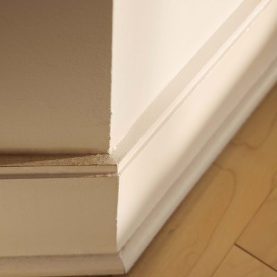 How to Cut a Baseboard on Uneven Floors
