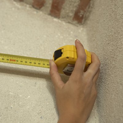 Hand using tape measure