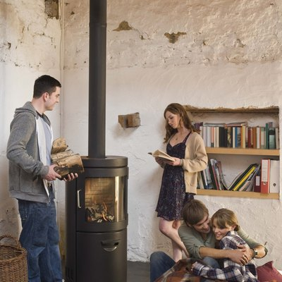 Friends around wood stove indoors