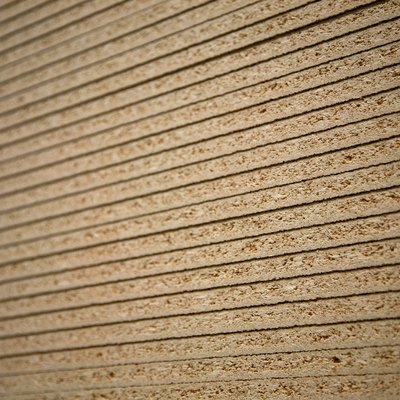 Sheets of particleboard stacked neatly