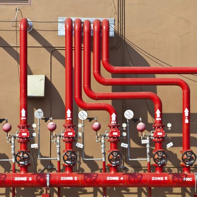 splinker alarm system, red water pipe, brown wall, outdoor
