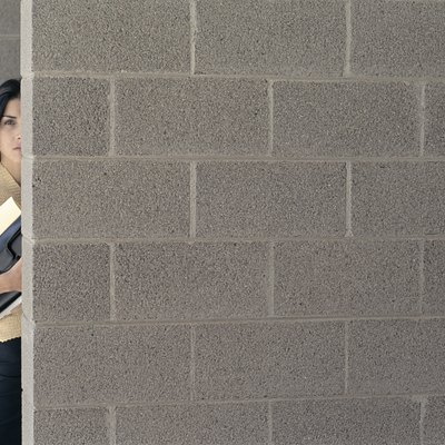 How to Glue Drywall to the Interior of Concrete Block Walls