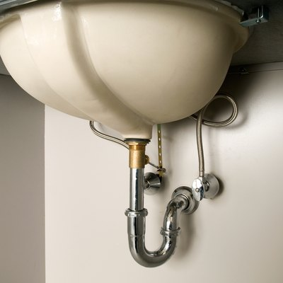 What Can I Do to Cover Exposed Plumbing Under My Bathroom Sink?