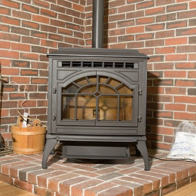 How to Hook Up a Wood Stove Through the Basement Window