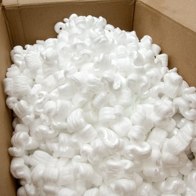 Open cardboard box with packing peanuts