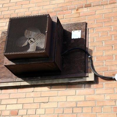 Fan mounted in sealed window of building