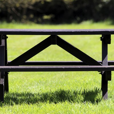 Image of wooden picnic table in field of mown grass