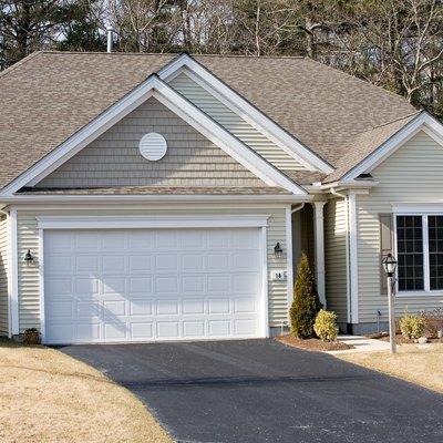 Exterior of garage with house
