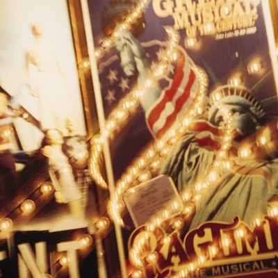 Broadway billboards , movie posters and marquee lights