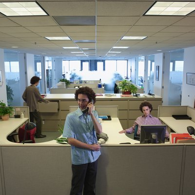 Young man working in office (Multiple Exposure)