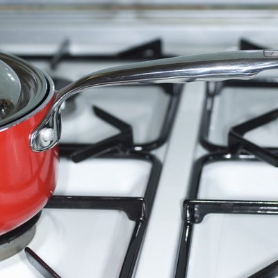 How to Clean Burnt-on Grease Off Enamel Gas Stove Burners