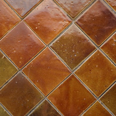 What Would Cause My Floor Tile to Buckle After 13 Years?