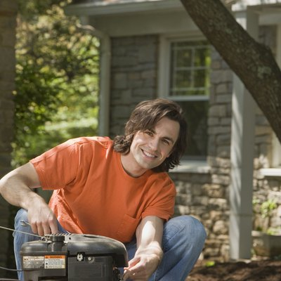 Smiling man with lawn mower