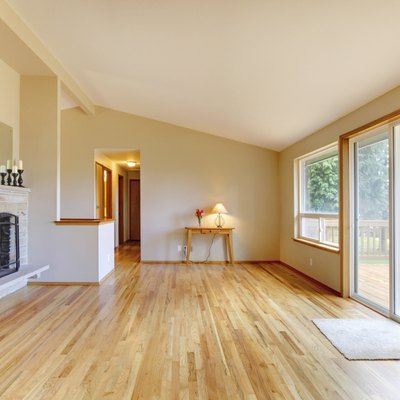 Empty living room with a fireplace and glass sliding door