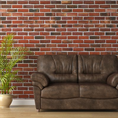 leather couch on brick wall
