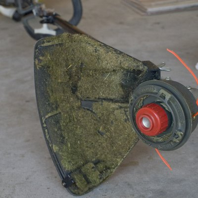 How to Hang a Weed Eater in a Garage