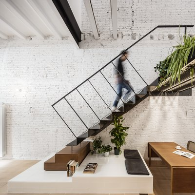 The Ground Floor of This Textured Barcelona Home Was Once a Store