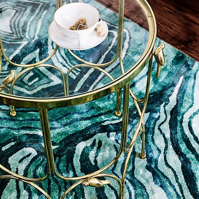 It's Time to Try Out the Layering Trend With These 11 Rugs