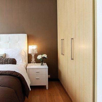 Bedroom setting with headboard and nightstand