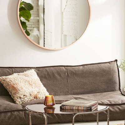 8 Designer-Approved Ways to Fill the Wall Above a Sofa