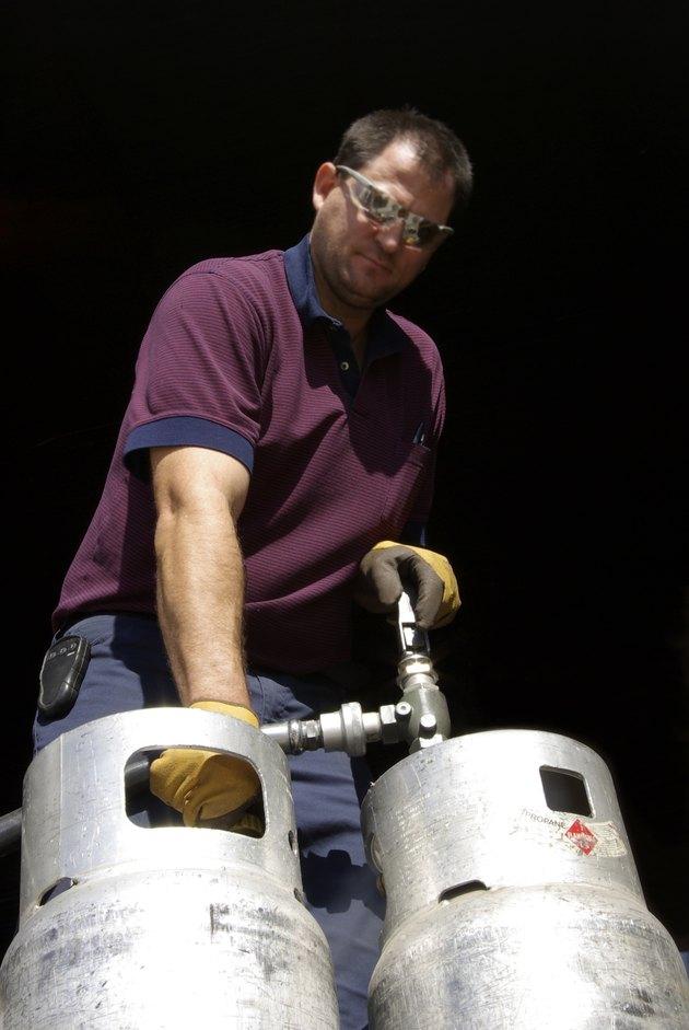 Working man filling propane