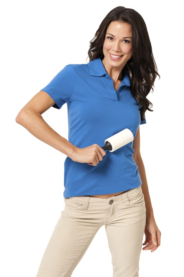 Casual Young Woman with Tape Lint Roller on White