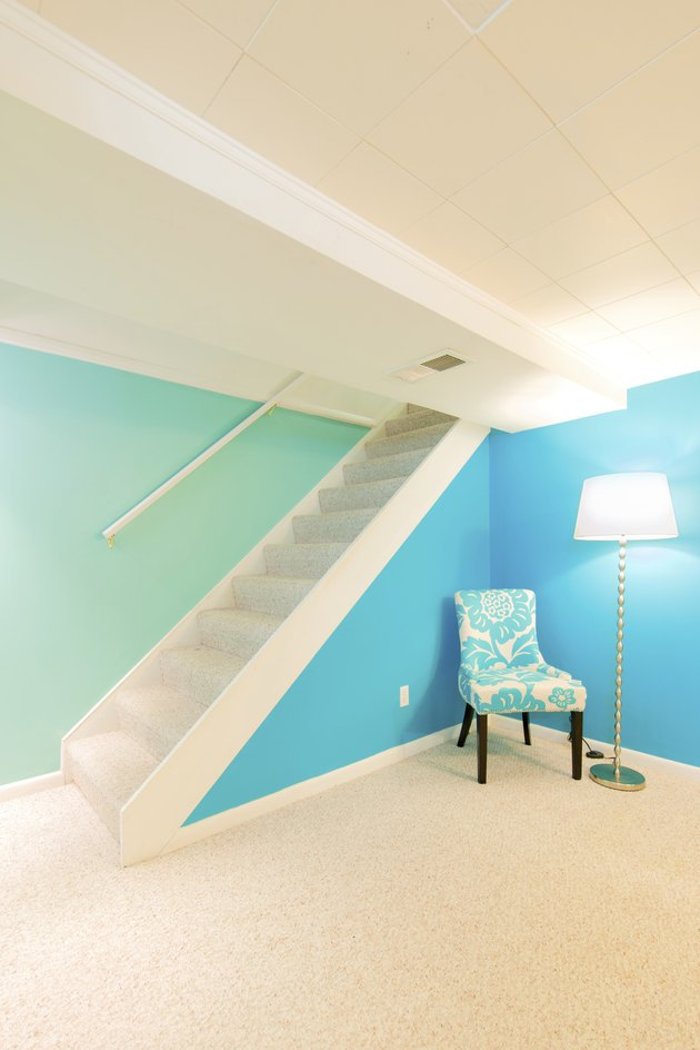 Colors and lighting brighten a finished basement in American mome