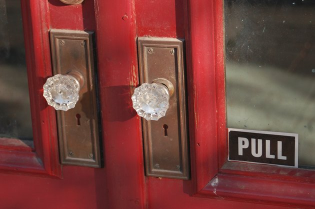 Antique red door with glass knobs