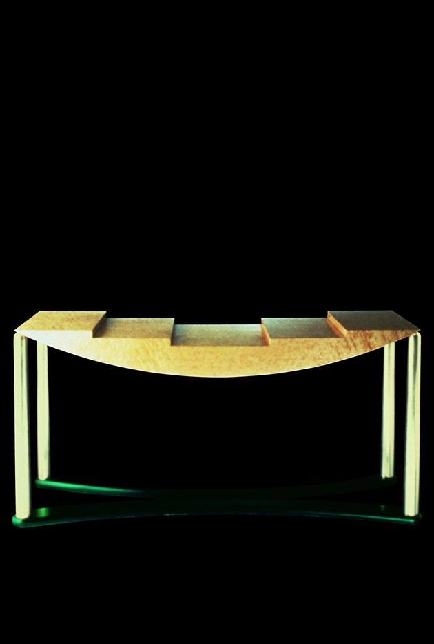 Table with curves and different level in Memphis style designed by Hans Hollein