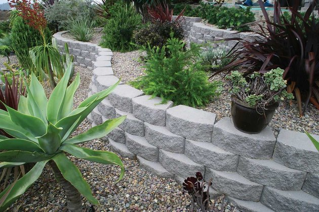 Concrete block retaining wall.