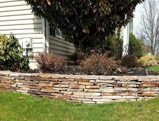 Stone retaining wall.